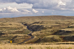 Winding road through Eastern Washington. Winding road through the scablands of Eastern Washington Stock Photos