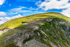 Winding road in Fagaras Mountains Royalty Free Stock Photo