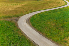 Winding road in the  field Royalty Free Stock Image