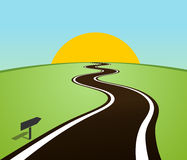 Winding road in the field over the horizon. Sun Royalty Free Stock Photography
