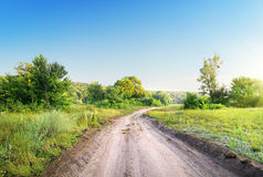 Winding road in a field Stock Photos