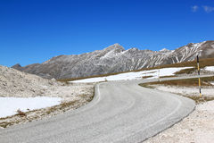 Winding road in Gran Sasso Park, Apennines, Italy. Gran Sasso d'Italia, a mountain located in the Abruzzo region of central Italy, forms the centrepiece of the stock images