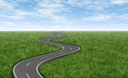 Winding road on green grass horizon Royalty Free Stock Image