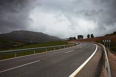A winding  road through hills. Stock Photos