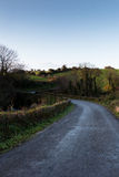 Winding road in Irish countryside. With a blue sky Royalty Free Stock Photos