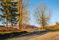 Winding road in late autumn mountains. Lovely transportation scenery Stock Photo