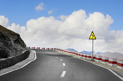 Twisty road and sky. Winding road leading to blue sky royalty free stock photography