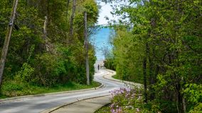 Winding Road Leading To The Lake royalty free stock photography