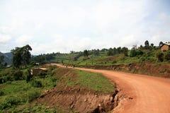 Winding Road Leading Through Uganda Stock Photo