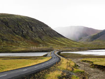 Winding Road. Lone winding road through the mountains in Iceland Stock Photography