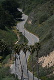 Winding Road. A lonely two-lane road winds around the mountains in Santa Barbara Stock Image