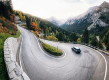 Winding road of Maloja Pass in Switzerland. Adventure trip by car along winding mountain alpine road, Maloja Pass, Switzerland Stock Photography