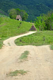 Winding road and a mountain hut Royalty Free Stock Images