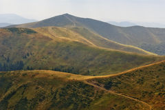 Winding road in a mountain valley. Stock Photography