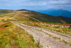 Winding road in a mountain valley. Stock Photos