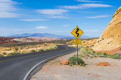 Winding road in a mountainous desert. Scenic landscape with winding road in Valley of the Fire park in Nevada, USA Royalty Free Stock Photography
