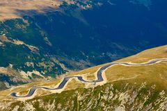 Winding road through mountains Stock Photography