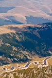 Winding road through mountains Stock Photos
