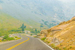 Winding road through mountains Stock Images