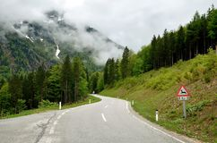 Winding road in mountains. The serpentine mountain road in Austrian Alps stock photography