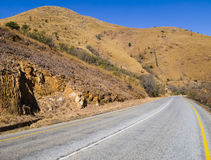 Winding road through the mountains of South Africa. Winding asphalt road through the mountains of South Africa Stock Image