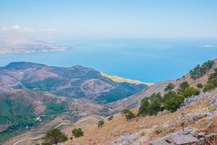 Winding road on mountainside at the coast with blue sky and ocean far below.Aerial view to sea from mountains. Travel Royalty Free Stock Photography