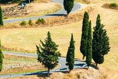 Winding road near Monticchiello and Pienza in Tuscany, Italy. Winding road in summer near Pienza in Tuscany, Italy stock image