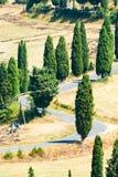 Winding road near Monticchiello and Pienza in Tuscany, Italy. Winding road in summer near Pienza in Tuscany, Italy royalty free stock photos