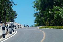 Winding road over a hill. Winding country-road over a hill royalty free stock photo