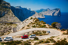 Winding road with parked cars on the Cap de Formentor Stock Image