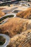 Winding road into Queenstown Tasmania. Aerial view of the highway winding its way down the mountain into the former copper mining town of Queenstown on the west royalty free stock image