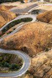 Winding road into Queenstown Tasmania. Aerial view of the highway winding its way down the mountain into the former copper mining town of Queenstown on the west stock photo