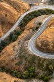 Winding road into Queenstown Tasmania. Aerial view of the highway winding its way down the mountain into the former copper mining town of Queenstown on the west royalty free stock photo