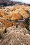 Winding road into Queenstown Tasmania. Aerial view of the highway winding its way down the mountain into the former copper mining town of Queenstown on the west stock image