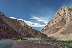 Winding road in ragged ravine mountains Royalty Free Stock Image