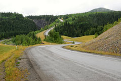 Winding road in river valley Royalty Free Stock Photo