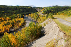 Winding road and river in valley Stock Images
