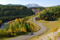 Winding road in river valley Stock Photography