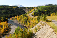 Winding road and river in valley Royalty Free Stock Image