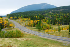 Winding road in river valley Stock Photo