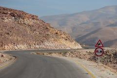 Roadsigns on desert road, Jordan Stock Image
