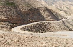 Winding road in the rocky desert Stock Photo