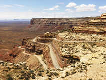 Winding Road on Rugged Desert Rock Formation Royalty Free Stock Images