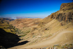 The winding road of Sani Pass, South Africa Stock Photos