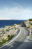 Winding road by the sea Stock Photography