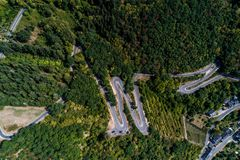 Winding road serpentine from a high mountain pass in the mosel village Brodenbach Germany Aerial view Royalty Free Stock Photo