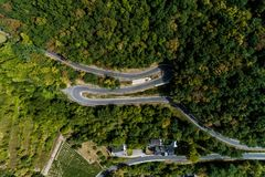 Winding road serpentine from a high mountain pass in the mosel village Brodenbach Germany Aerial view Stock Images