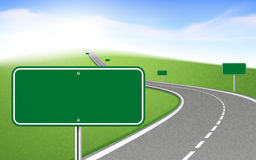 Winding road with several road signs Stock Photo