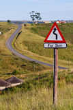 Winding Road Sign. On a hill Stock Photos