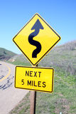Winding road sign. Next 5 miles Stock Photo